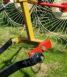 Shows bracket to change raking angle for shorter grass.