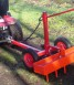 Light implement carrier with a levelling harrow for levelling ruts and heavy harrowing.